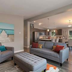 Barnard's Village Living Room ranch style homes in vernon presale